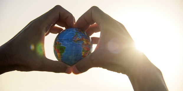 Globe earth hand