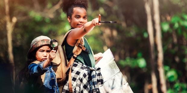 Kids map exploring woods